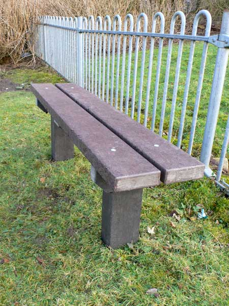 Recycled plastic park or garden bench with extended leg for secure fixing