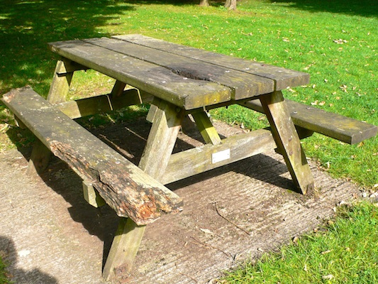 rotten wooden picnic table