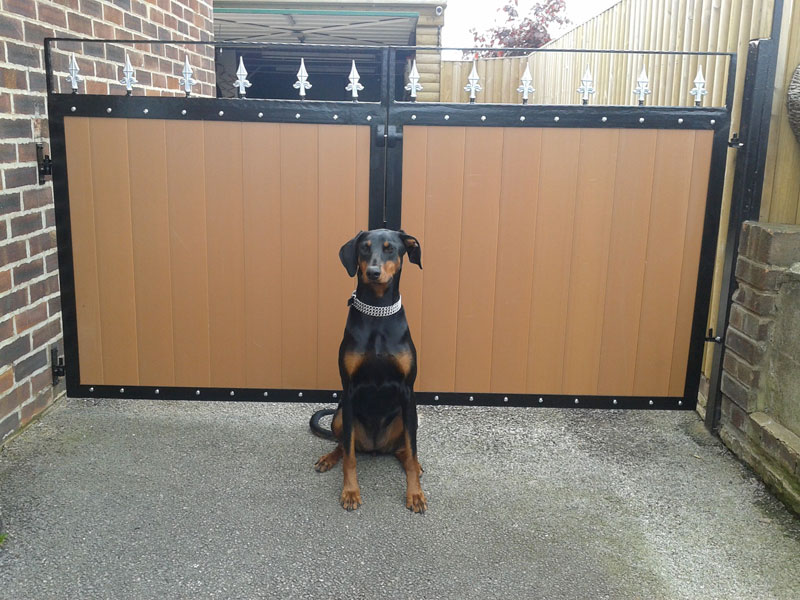 Steel gates infilled with recycled plastic wood tongue and groove oak profiles