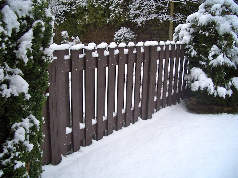 Recycled plastic fence impervious to snow and ice